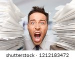 young businessman with stack of ... | Shutterstock . vector #1212183472