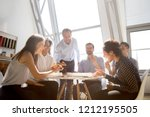 cheerful diverse team people... | Shutterstock . vector #1212195505