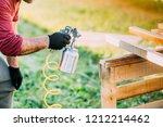 industrial worker using paint... | Shutterstock . vector #1212214462