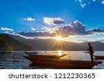 a person on a canoe on a vast... | Shutterstock . vector #1212230365