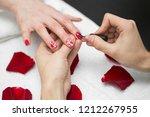 manicure. closeup of beautiful... | Shutterstock . vector #1212267955