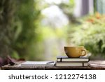yellow ceramic cup with... | Shutterstock . vector #1212274138