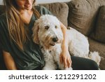 Stock photo woman and her dog at home 1212291202