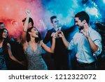 happy young people dancing on...   Shutterstock . vector #1212322072