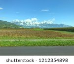 field with cloudy hills in the... | Shutterstock . vector #1212354898