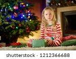 cute little girl feeling...   Shutterstock . vector #1212366688