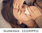 sick woman with seasonal... | Shutterstock . vector #1212409912