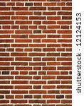 Red brick wall close up background. - stock photo