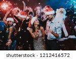 happy young people dancing on...   Shutterstock . vector #1212416572