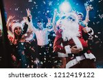man in santa claus costume on... | Shutterstock . vector #1212419122
