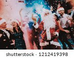 man in santa claus costume on... | Shutterstock . vector #1212419398