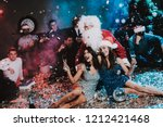 two young women with santa... | Shutterstock . vector #1212421468