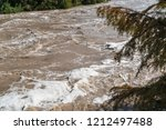 flood waters rushing down the... | Shutterstock . vector #1212497488