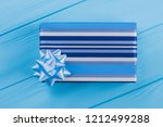 blue striped gift box. top view.... | Shutterstock . vector #1212499288