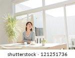 beautiful young woman relaxing...   Shutterstock . vector #121251736