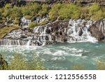 hraunfossar waterfall in...   Shutterstock . vector #1212556558