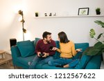 happy attractive young couple... | Shutterstock . vector #1212567622