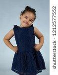 posing cute little girl on gray ...   Shutterstock . vector #1212577552