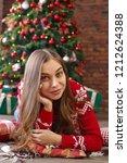 beautiful young woman lies... | Shutterstock . vector #1212624388