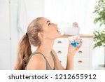 woman rinsing mouth with... | Shutterstock . vector #1212655912