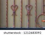wrought iron gates  ornamental... | Shutterstock . vector #1212683092