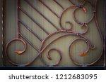 wrought iron gates  ornamental... | Shutterstock . vector #1212683095