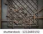 wrought iron gates  ornamental... | Shutterstock . vector #1212683152