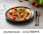 omelet with tomatoes and herbs. ... | Shutterstock . vector #1212788995