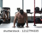 muscular man stretches at the...   Shutterstock . vector #1212794335