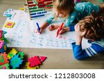 little boy and girl learn to... | Shutterstock . vector #1212803008