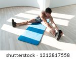 muscular man stretches at the...   Shutterstock . vector #1212817558