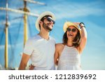 happy young couple walking by... | Shutterstock . vector #1212839692