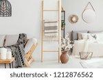 wooden ladder with blanket... | Shutterstock . vector #1212876562
