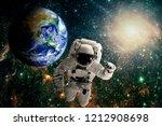 astronaut flies over the earth...   Shutterstock . vector #1212908698