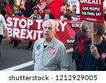 Small photo of LONDON, UNITED KINGDOM - OCTOBER 20, 2018: People's Vote March, demanding a second referendum on Brexit. Man with sticker reading, 'Love Corbyn, Hate Brexit' in front of 'Stop Tory Brexit' banner.