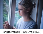 sad woman portrait looking out... | Shutterstock . vector #1212951268