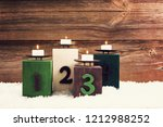 four candles on blocks with the ...   Shutterstock . vector #1212988252