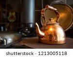 Copper Tea Pot On A Wood...
