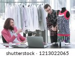 two fashion designers are... | Shutterstock . vector #1213022065