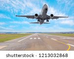 White Passenger plane fly up over take-off runway from airport  - stock photo