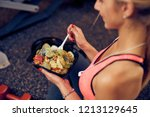 top view of woman eating... | Shutterstock . vector #1213129645