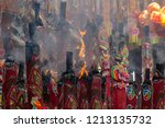 burning of incense sticks in a... | Shutterstock . vector #1213135732