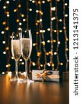 glasses of champagne and... | Shutterstock . vector #1213141375
