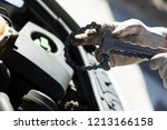 oil change in car. man... | Shutterstock . vector #1213166158