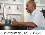 man working in his home office.   Shutterstock . vector #1213211398