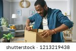 handsome excited man opens... | Shutterstock . vector #1213219438