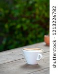 coffee on a wooden table   Shutterstock . vector #1213226782