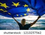 man holding eu european union...   Shutterstock . vector #1213257562