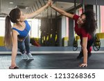 high five at gym  fitness girls ... | Shutterstock . vector #1213268365