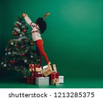 kid reaching for the top of a... | Shutterstock . vector #1213285375